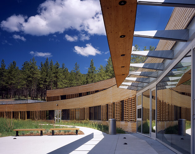 Nicola Valley Institute of Technology<abbr>Merritt, B.C. Canada<br>Douglas fir glulam beams, yellow cedar rainscreen wall and moveable sun shading louvres</abbr>