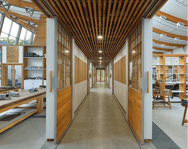 CEPT University Workshop<abbr> Ahmedabad, Gujarat <br>Douglas fir glulam beams, western hemlock false ceiling and panelling, yellow cedar doors</abbr>