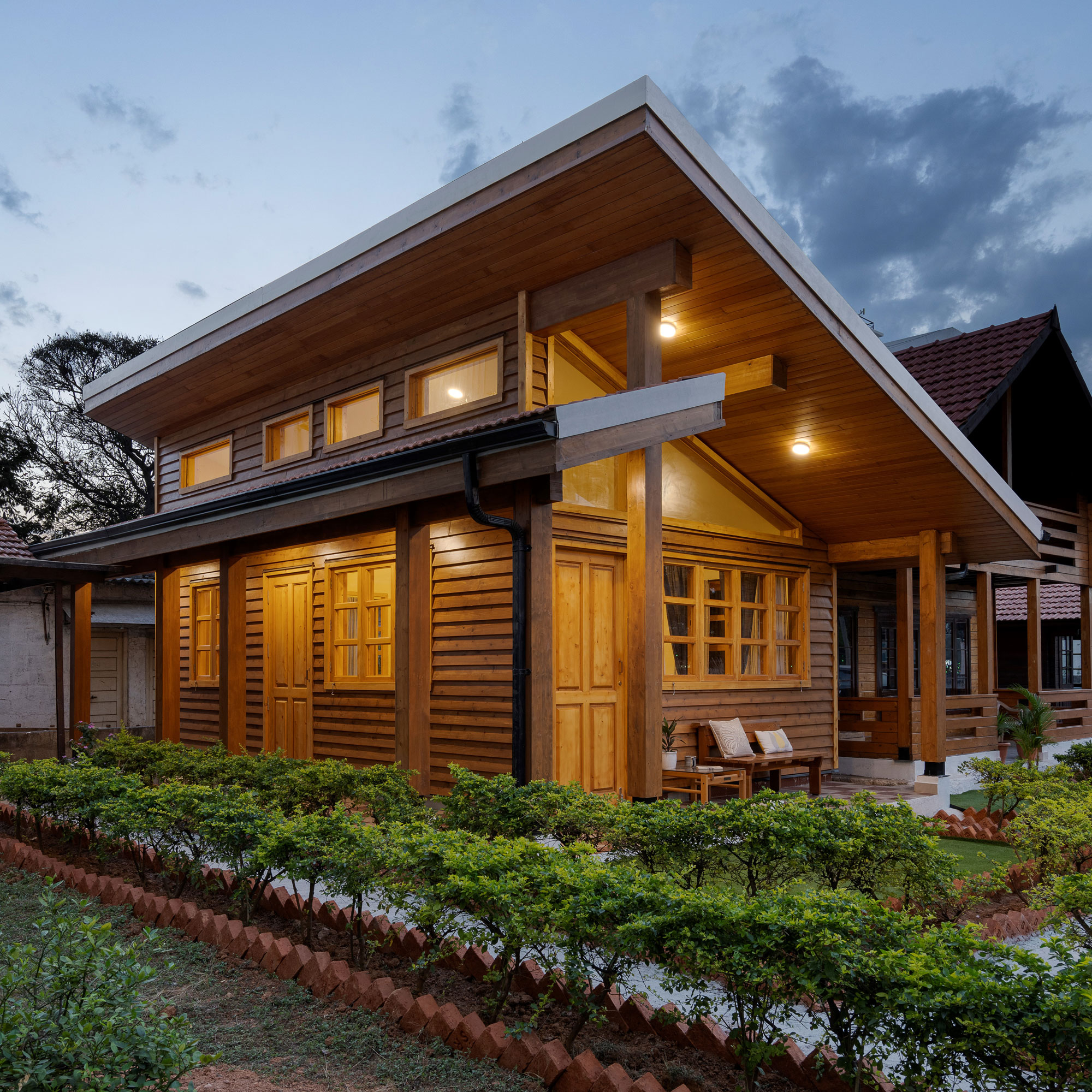 Wood Frame Construction studio cottage<abbr> Bengaluru<br>S-P-F used for structural purposes, yellow cedar for doors and windows and Western hemlock for furniture.</abbr>